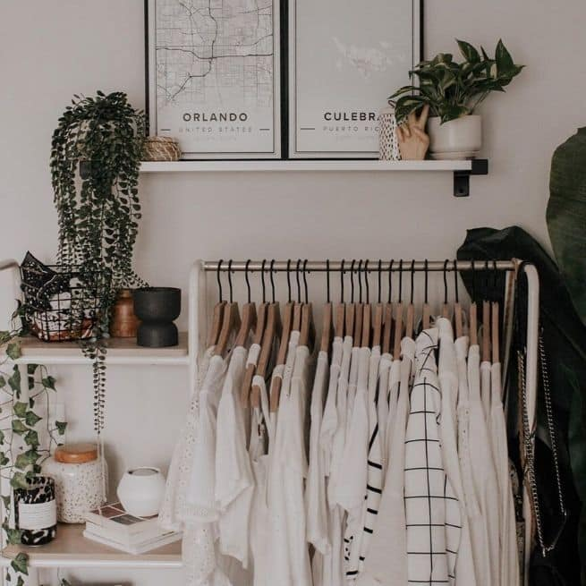 give back to the community by cleaning out your closet, clothing rail in a bedroom